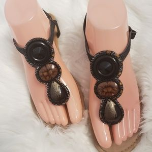 Liliana brown and black beaded flat sandals.